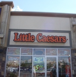 Store front for Little Caesar's Pizza House
