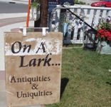 Store front for On A Lark Antiquities & Uniquities